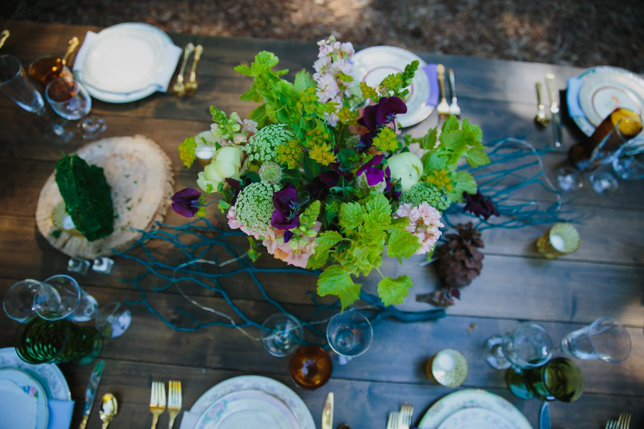 Looking at the table of flowers and place-settings from above.