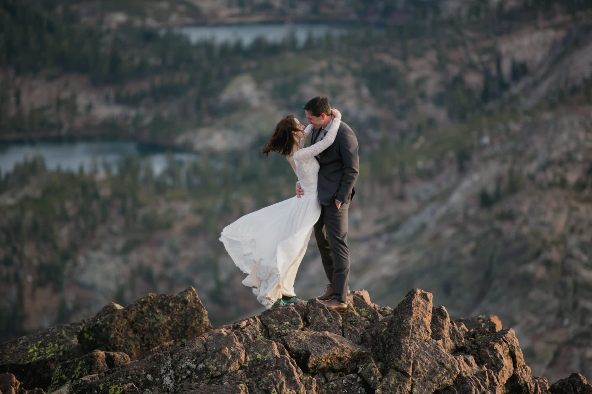 Newlyweds on a windy California mountaintop.