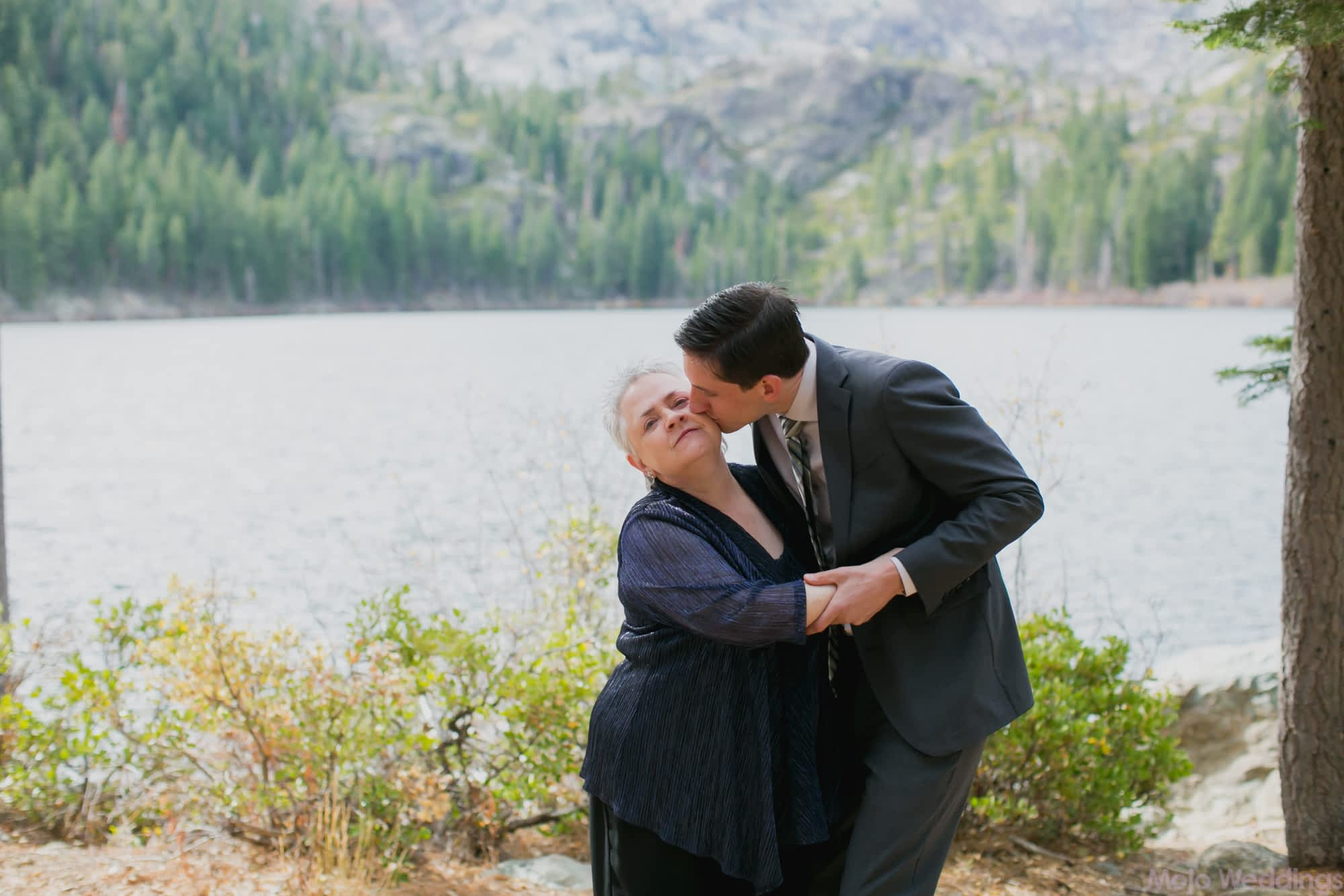 The groom kisses his mother.