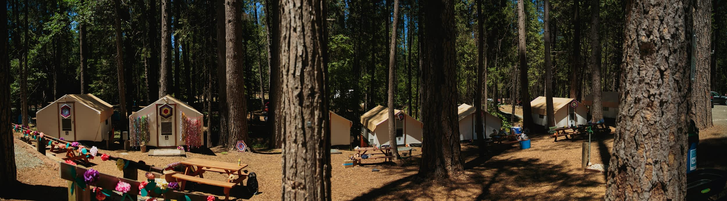 A pano of a row of cabins at the Inn Town Campground.